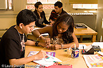 Education High School physics lab on electrical circuits male and female lab partners working together horizontal