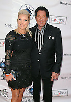 MIAMI, FL - NOVEMBER 10:  Wayne Newton (R) and wife Kathleen McCrone attend Destination Fashion 2012 To Benefit The Buoniconti Fund To Cure Paralysis, the fundraising arm of The Miami Project to Cure Paralysis, on November 10, 2012 in Miami, Florida.  © MPI10/MediaPunch Inc