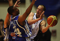 Giants guard Phill Jones tries to pass around Ernest Scott during the NBL Semifinal basketball match between the Wellington Saints and Nelson Giants at TSB Bank Arena, Wellington, New Zealand on Thursday, 12 June 2008. Photo: Dave Lintott / lintottphoto.co.nz