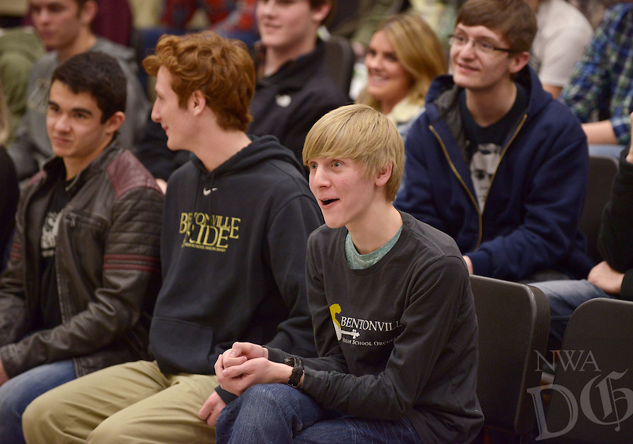 NWA Democrat-Gazette/BEN GOFF @NWABENGOFF<br /> James Bouwhuis, a sophomore who studies piano, listens on Friday Jan. 27, 2017 as Natasha Paremski, a pianist from New York, talks to a group of music students at Bentonville High School. Paremski played several pieces before taking questions from students at the event, which was part of Symphony of Northwest Arkansas's ongoing community educational outreach. Paremski is in Northwest Arkansas to perform with the symphony at their Masterworks I: 'Momentum' concert at 7:30pm on Saturday at the Walton Arts Center in Fayetteville. Paremski was born in Moscow, Russia and began studying piano at age 4 before moving the United States and becoming a citizen at age 8.