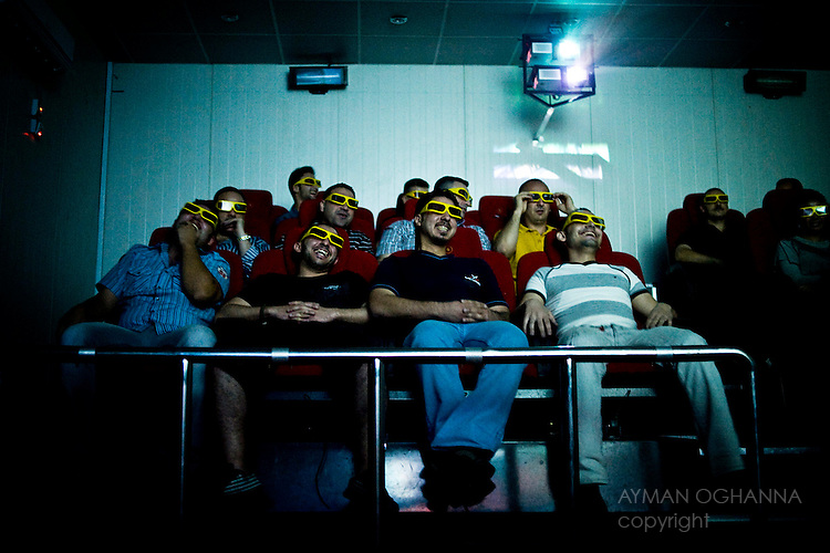 Baghdad, Iraq  : Tue 12th Oct 2010 :..Baghdadis enjoying a show at the recently opened New Vision 4D cinema in Baghdad's Zayuna district.