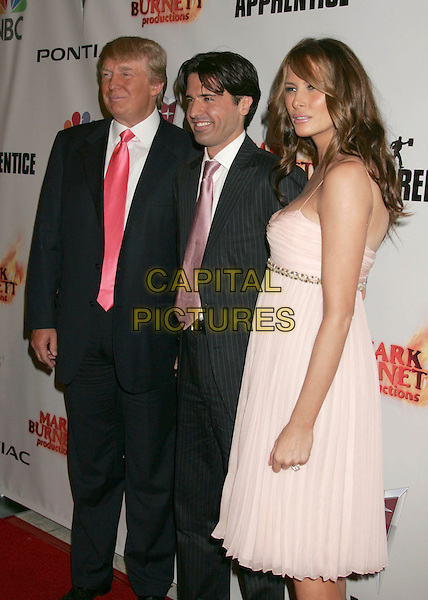 "DONALD TRUMP, SEAN YAZBECK & MELANIA KNAUSS TRUMP .""The Apprentice"" Season Five Finale After Party held at California Market Center. .June 5th, 2006.Photo: Russ Elliot/AdMedia/Capital Pictures.Ref: RE/ADM.half length pink dress husband wife spaghetti strap black blue suit.www.capitalpictures.com.sales@capitalpictures.com.© Capital Pictures."