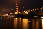 San Francisco's Golden Gate Bridge at night taken with a zoom lens at a very slow shutter speed from Fort Baker Pier  in Sausalito, California.