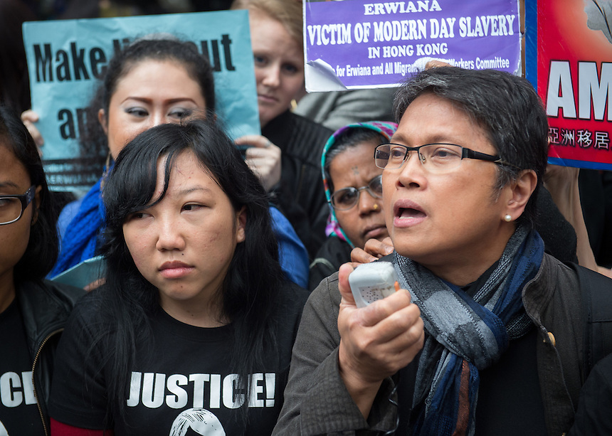 Abused Indonesian domestic helper Erwiana Sulistyaningsih talks to the media on the steps of the District Court in Wan Chai, Hong Kong. She suffered abuse at the hands of Law Wan-tung who was sentenced to six years in prison today.27th February 2015 27.02.15<br /> &copy;Jayne Russell
