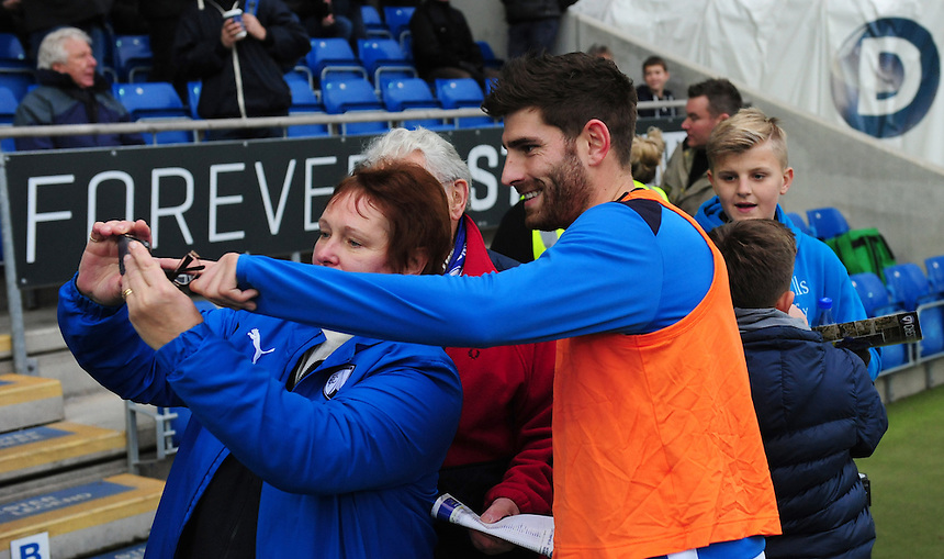 Chesterfield's Ched Evans poses for a selfie with a fan during the pre-match warm-up <br /> <br /> Photographer Chris Vaughan/CameraSport<br /> <br /> The Emirates FA Cup Second Round - Chesterfield v Wycombe Wanderers - Saturday 3rd December 2016 - Proact Stadium - Chesterfield<br />  <br /> World Copyright &copy; 2016 CameraSport. All rights reserved. 43 Linden Ave. Countesthorpe. Leicester. England. LE8 5PG - Tel: +44 (0) 116 277 4147 - admin@camerasport.com - www.camerasport.com