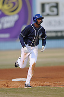 Asheville Tourists first baseman Correlle Prime #32 rounds the bases after homering during a game against the Delmarva Shorebirds at McCormick Field on April 5, 2014 in Asheville, North Carolina. The Tourists defeated the Shorebirds 5-3. (Tony Farlow/Four Seam Images)