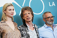 "VENICE, ITALY - SEPTEMBER 07: (L-R) Elizabeth Debicki, Mick Jagger and Giuseppe Capotondi attend ""The Burnt Orange Heresy"" photocall during the 76th Venice Film Festival at Sala Grande on September 07, 2019 in Venice, Italy. (Photo by Mark Cape/Insidefoto)<br /> Venezia 07/09/2019"