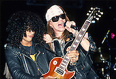 Guns n' Roses - guitarist Slash and vocalist Axl Rose Performing live at the Spectrum in Philadelphia, PA USA - Aug 4,1988.  Photo credit: Eddie Malluk/AtlasIcons.com