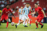 Paulo Dybala of Argentina (C) takes a dribble on Daniel Bannett of Singapore (R) during the International Test match between Argentina and Singapore at National Stadium on June 13, 2017 in Singapore. Photo by Marcio Rodrigo Machado / Power Sport Images