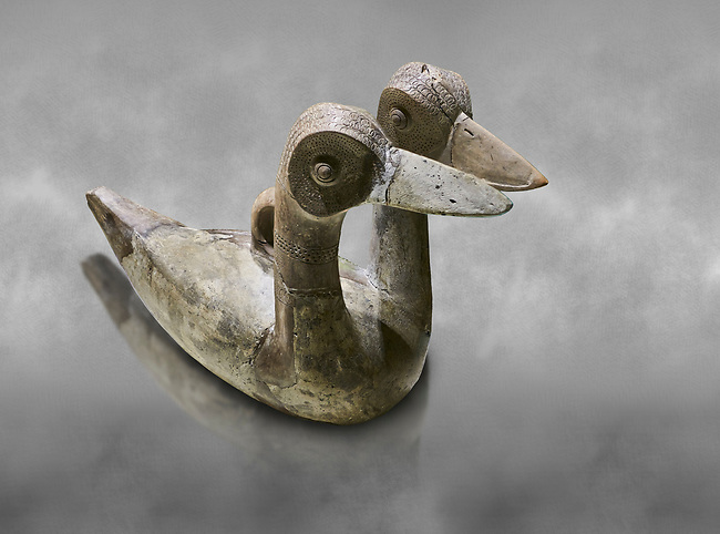 Hittite terra cotta ritual vessel in the shape of a duck with two heads - 16th century BC - Hattusa ( Bogazkoy ) - Museum of Anatolian Civilisations, Ankara, Turkey . Against grey art background