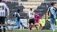 Aaron Pierre of Wycombe Wanderers clears a Ronan Murray of Notts County attempt during the Sky Bet League 2 match between Notts County and Wycombe Wanderers at Meadow Lane, Nottingham, England on 28 March 2016. Photo by Andy Rowland.