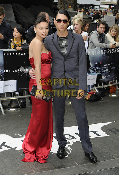 Leah and Natt Weller.'The Dark Knight Rises' European premiere at Odeon Leicester Square cinema, London, England..18th July 2012.full length grey gray suit black dress clutch bag side strapless brother sister siblings family .CAP/PP/BK.©Bob Kent/PP/Capital Pictures.