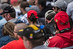 Spectators use portable TVs to watch the F1 Grand Prix du Canada at the Circuit Gilles-Villeneuve on June 08, 2012 in Montreal, Canada. Photo by Victor Fraile / The Power of Sport Images