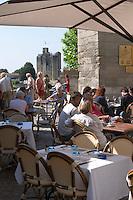 A cafe with a view over the Tour du Roy. The town. Saint Emilion, Bordeaux, France