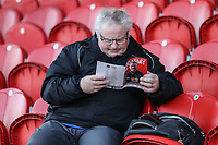 A Fleetwood Town supporters studies the match day programme ahead of the Sky Bet League 1 match between Fleetwood Town and MK Dons at Highbury Stadium, Fleetwood, England on 24 February 2018. Photo by David Horn / PRiME Media Images