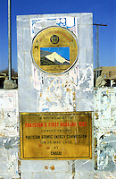 © Piers Benatar/Panos Pictures..Baluchistan, Pakistan. 2001...Pakistan is very proud of its status as the only Muslim nuclear power, a pride which manifests itself in sculptures, murals and merchandising paraphernalia depicting its Ghauri and Shaheen missiles. A commemorative plate in the village of Chagai, near to the Chagai hills where Pakistan conducted its first underground nuclear test in May 1998.