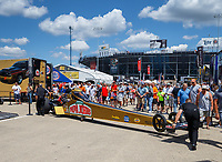 Jul 8, 2017; Joliet, IL, USA; Crew members move the dragster of NHRA top fuel driver Leah Pritchett during qualifying for the Route 66 Nationals at Route 66 Raceway. Mandatory Credit: Mark J. Rebilas-USA TODAY Sports