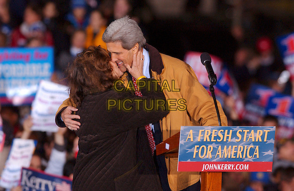 TERESA HEINZ KERRY & JOHN KERRY .Presidential Candidate during an election eve rally held near Cleveland City Hall, Cleveland, Ohio, USA, 1st November 2004..half length wife husband married kissing senator.**UK SALES ONLY**.Ref: ADM.www.capitalpictures.com.sales@capitalpictures.com.©Capital Pictures.
