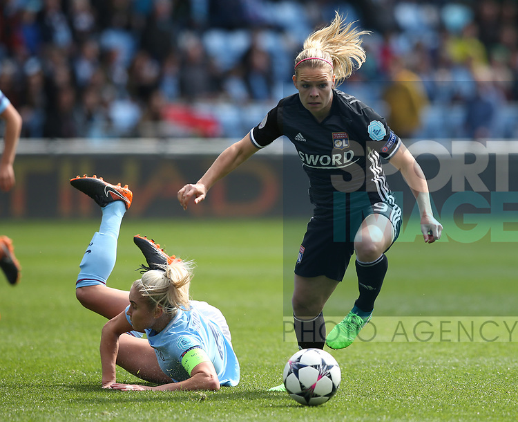 Eugenie Le Sommer of Lyon turns Steph Houghton of Manchester City during the Women's Champions League, Semi Final 1st leg match at the Academy Stadium, Manchester. Picture date 22nd April 2018. Picture credit should read: Simon Bellis/Sportimage