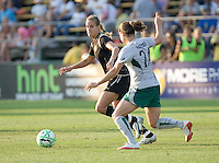 Leslie Osborne (left) looks to pass the ball, pursued by Kendall Fletcher (24). FC Gold Pride tied the St. Louis Athletica 1-1 at Buck Shaw Stadium in Santa Clara, California on August 9, 2009.