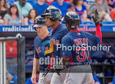 8 March 2015: Boston Red Sox infielder Xander Bogaerts (center) comes home to score after hitting a three run homer during Spring Training action against the New York Mets at Tradition Field in Port St. Lucie, Florida. The Mets fell to the Red Sox 6-3 in Grapefruit League play. Mandatory Credit: Ed Wolfstein Photo *** RAW (NEF) Image File Available ***