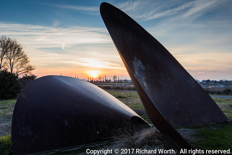 "The ""Duplex Cones"" at sunset, a work of urban art at the Martin Luther King Jr. Regional Shoreline across from the Oakland International Airport on San Francisco Bay"