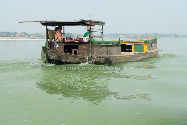 Asia, Vietnam, near Hoi An. Barge on the Thu Bon river nearing Hoi An.