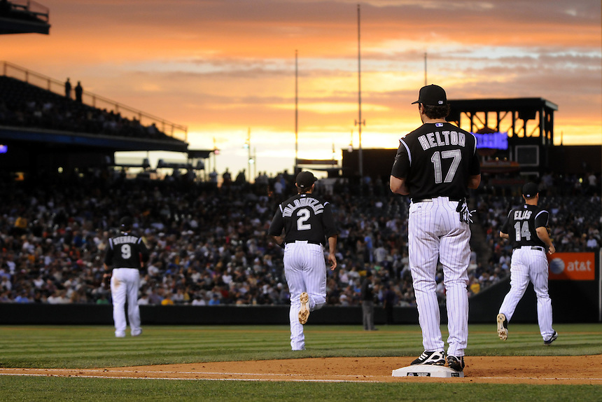 14 JULY 2011: The Colorado Rockies infield ( first baseman Todd Helton (17),  third baseman Ian Stewart (9),  shortstop Troy Tulowitzki (2), and  second baseman Mark Ellis (14) as the sun sets during a regular season game between the Milwaukee Brewers and the Colorado Rockies at Coors Field in Denver, Colorado. The Rockies beat the Brewers 12-3. *****For Editorial Use Only*****