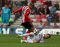 SUNDERLAND, ENGLAND - MAY 13: Gylfi Sigurdsson of Swansea City lies on the ground as he is fouled by Wahbi Khazri of Sunderland during the Premier League match between Sunderland and Swansea City at the Stadium of Light, Sunderland, England, UK. Saturday 13 May 2017