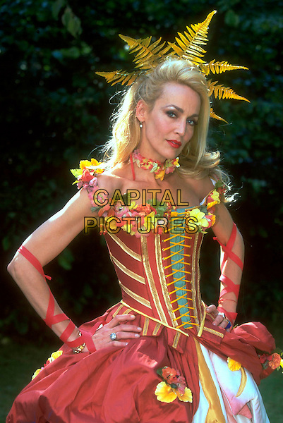 JERRY HALL.Ref: JM9858.half length red flowers corset hands on hips costume.www.capitalpictures.com.sales@capitalpictures.com.©James McCauley/Capital Picturesc