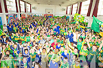 SHOUT: Hands up by the Pupils of CBS Clounalour School on Friday as teh Sam Maguire arrived at the School with Micheal Quirke, Tommy and Barry John Walsh and David Moran all of the 2009 Kerry winning team..
