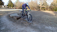 NWA Democrat-Gazette/FLIP PUTTHOFF <br /> A skills loop is now part of the soft trail at Lake Fayetteville. Pack bumps over boulders during a ride Feb. 3 2017 around the lake.