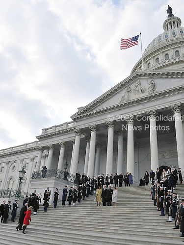 Washington, DC - January 20, 2009 -- Scene on the East Front of the United States Capitol where Vice President Joseph Biden and his wife, Jill, lower left are walking up the steps after saying farewell to former Vice President Dick Cheney and his wife, Lynne.  United States President Barack Obama and first lady Michelle Obama wait with former United States President George W. Bush and his wife, Laura (lower center) in Washington, D.C. on Tuesday, January 20, 2009..Credit: Ron Sachs - Pool via CNP