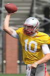 Jeff Tuel (#10), Washington State sophomore quarterback, fires a pass down field during the Cougars fall camp workout at Rogers Practice Field on the WSU campus in Pullman, Washington, on August 11, 2010.