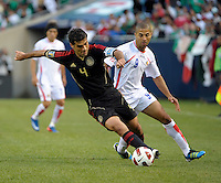 Mexico's Rafael Marquez dribbles away from Costa Rica's Alvaro Saborio.  Mexico defeated Costa Rica 4-1 at the 2011 CONCACAF Gold Cup at Soldier Field in Chicago, IL on June 12, 2011.