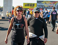 Sep 3, 2018; Clermont, IN, USA; NHRA top fuel driver Billy Torrence (right) with wife Kay Torrence during the US Nationals at Lucas Oil Raceway. Mandatory Credit: Mark J. Rebilas-USA TODAY Sports