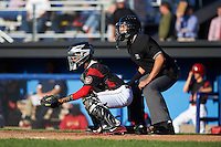 Batavia Muckdogs catcher Pablo Garcia (7) and umpire Raul Moreno await the pitch during a game against the State College Spikes on June 23, 2016 at Dwyer Stadium in Batavia, New York.  State College defeated Batavia 8-4.  (Mike Janes/Four Seam Images)