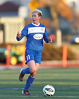 Boston Breakers midfielder Joanna Lohman (11) brings the ball forward and looks to pass. In a National Women's Soccer League Elite (NWSL) match, the Boston Breakers (blue) tied the Washington Spirit (white), 1-1, at Dilboy Stadium on April 14, 2012.