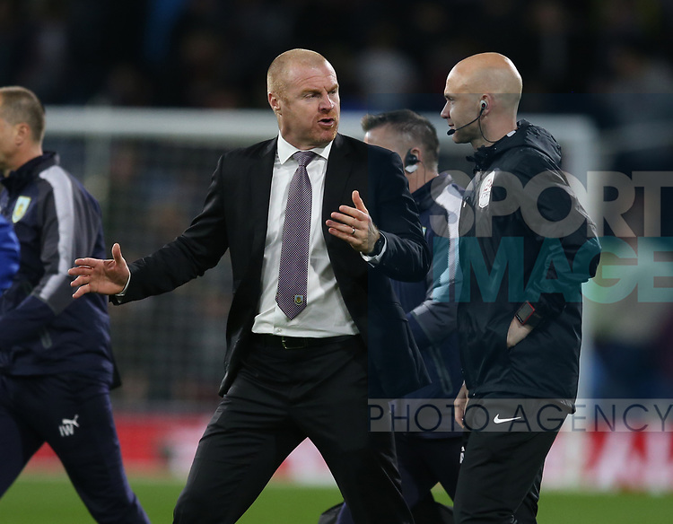 Sean Dyche manager of Burnley talks to the court official as they walk off at half time during the premier league match at the Turf Moor Stadium, Burnley. Picture date 19th April 2018. Picture credit should read: Simon Bellis/Sportimage