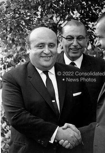 """United States President Richard M. Nixon, far right, shakes hands with Prime Minister Süleyman Demirel of Turkey, left, at the White House in Washington, DC on April 1, 1969.  Prime Minister Demirel was visiting the Nation's Capital for the State Funeral of former US President Dwight D. Eisenhower.  At center is Melih Esembel, Ambassador of Turkey to the US.<br /> Credit: Benjamin E. """"Gene"""" Forte / CNP"""