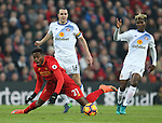 Divock Origi of Liverpool falls over after getting past John O'Shea of Sunderland during the Premier League match at the Anfield Stadium, Liverpool. Picture date: November 26th, 2016. Pic Simon Bellis/Sportimage