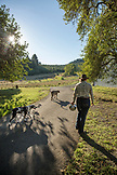 USA, Oregon, Willamette Valley, Clare Carver walks to the barn to retrieve her horses at Big Table Farms Winery, Gaston