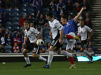 Danny Carmichael (left) and Nicky Clark combine against Ian Black in the Rangers v Queen of the South Quarter Final match in the Ramsdens Cup played at Ibrox Stadium, Glasgow on 18.9.12.