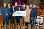 Darkness Into Light Nathan's Walk presenting a cheque to Pieta House at the Killarney Cathedral last Friday night. Pictured are l-r Niall O'Sullivan, Fr Kieran O'Brien, Damien O'Carroll, Cahill Walsh, Marie and Denis O'Carroll, Marie Peelo, Chris Manton and Killian O'Carroll.