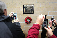 Pictured: Swansea supporters taking pictures with their mobile phonres of the unveiled plaque Sunday 09 November 2014<br />