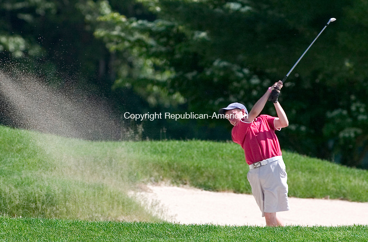 BERLIN, CT. 26 May 2010-052610SV01--Brian Quilter of Wolcott High School digs himself out of a sand trap on the 15th fairway during the NVL Golf Tournament at Timberlin Golf Course in Berlin Wednesday.<br /> Steven Valenti Republican-American