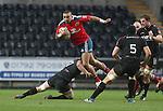 Munster wing Simon Zebo tries to jump over the tackle of Ospreys flanker Sam Lewis.<br /> RaboDirect Pro12<br /> Ospreys v Munster<br /> Liberty Stadium<br /> 23.02.14<br /> <br /> ©Steve Pope-SPORTINGWALES