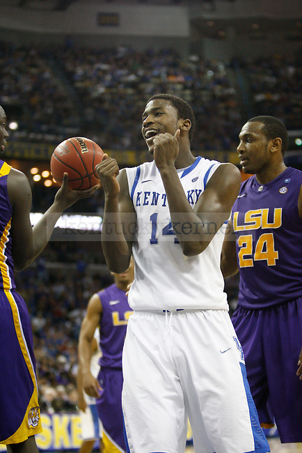 """UK forward Michael Kidd-Gilchrist after teammate Anthony Davis gets an """"and 1"""" during the second half in the 2012 SEC Tournament game between Kentucky and LSU, played at the New Orleans Arena, on 3/9/12.  Photo by Quianna Lige 
