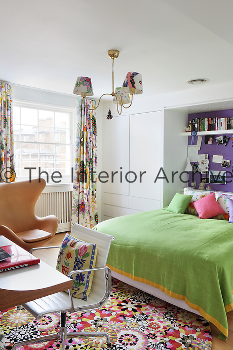 Multi-coloured soft furnishings give this room a distinctly seperate character from the formality of the rest of Kate Groes's house