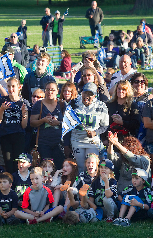 Seahawks fans cheer as they watch a performance in Marshall Park in Vancouver Friday July 15, 2016. A star wars movie was shown on the lawn following a Seahawks event. (Photo by Natalie Behring/ for the The Columbian)